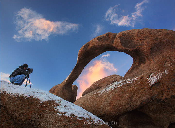 A photographer photographing Mobius Arch in the Alabama Hills near Lone Pine, California.